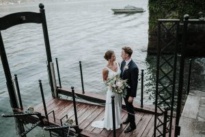 bride and groom on the water in lake como